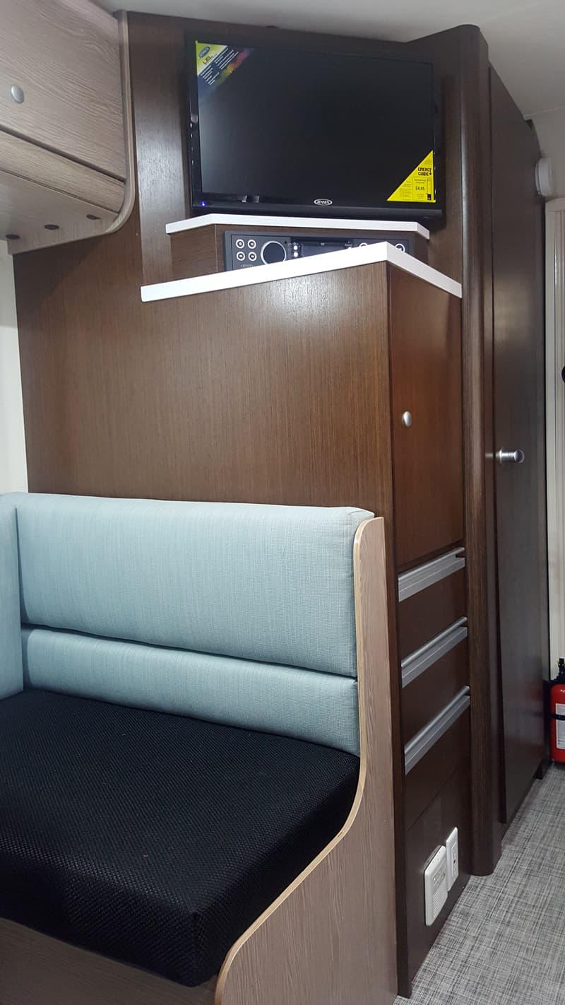 Cirrus 920 Storage behind dinette and bath