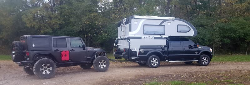 Cirrus Camper with towed Jeep