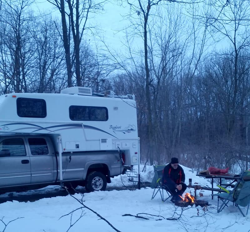 Bigfoot camper campfire winter