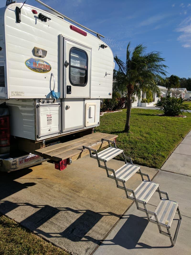 Rear camper deck and scissor steps