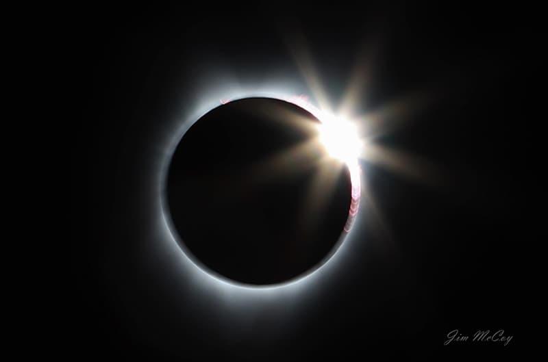 Diamond ring moon over sun