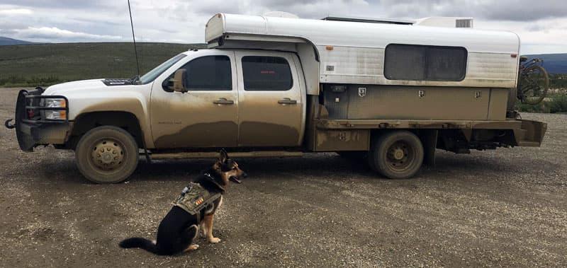Dirty camper driving through Alaska