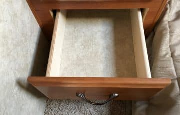 Empty drawer before end table