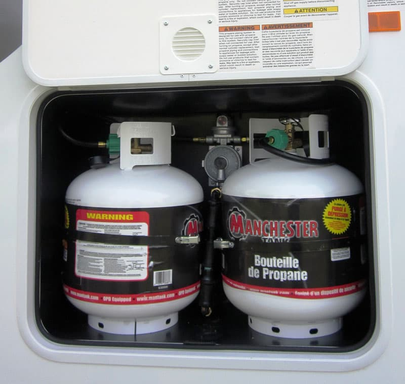 Eagle Cap 811 two vertical 20-pound propane tanks
