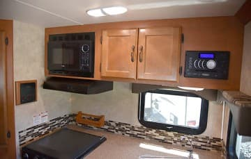 Eagle Cap 995 upper kitchen cabinetry and microwave and stereo