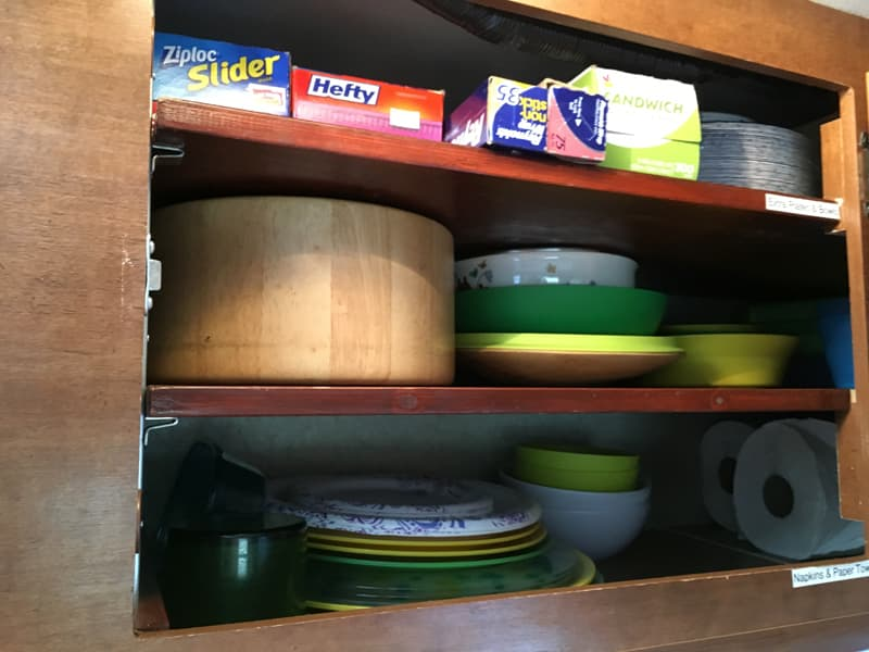 kitchen cupboards with bowls and cups
