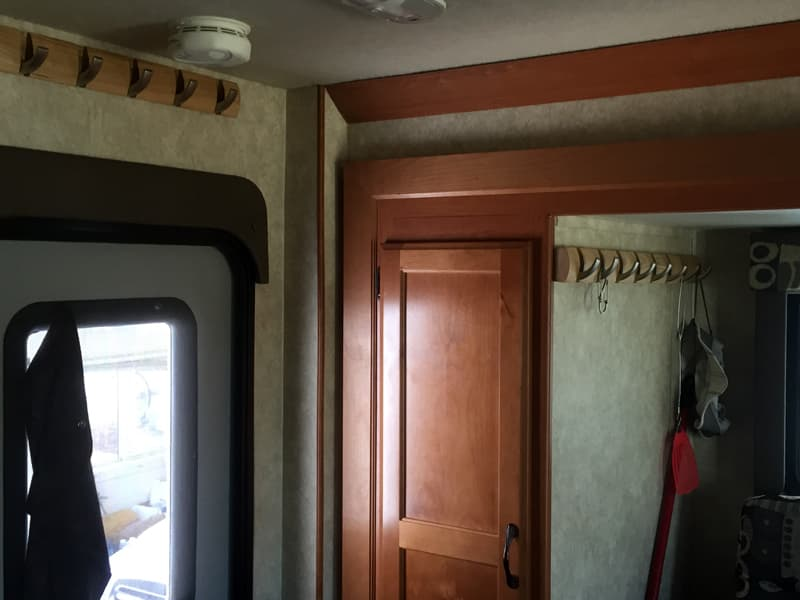 Extra hooks by the door of the camper