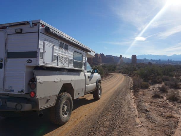 #261 - K PawleyArches National Park, Utah2005 Silverado HD2016 Four Wheel Camper GrandbyCamera Used - Sony Alpha 5100In October 2016 my wife and I quit our jobs to travel the Americas.  We'd only been on the road for a week or so and were camping on BLM land outside Moab and Arches National Park.  While sitting around the fire that night, I was looking over the maps and noticed the small dirt road that passed our campsite appeared to wind its way into the National Park.Turns out BLM RD378 (Willow Springs) is one of two alternate entrances into the park.  We're always looking for excuses to avoid pavement, and this was a more direct route to boot!  The washes and slickrock ledges on the BLM portion of the road made for a fun morning and a far more dramatic entry into Arches than the main gate.