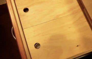 False bottom drawer covered