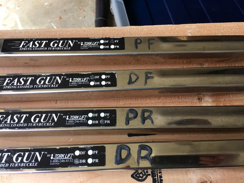 Fastgun labels dark nail polish with initials