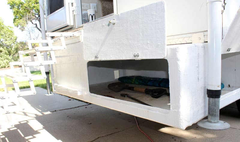 White gel coat was applied and the box was mounted the overhang of the camper.