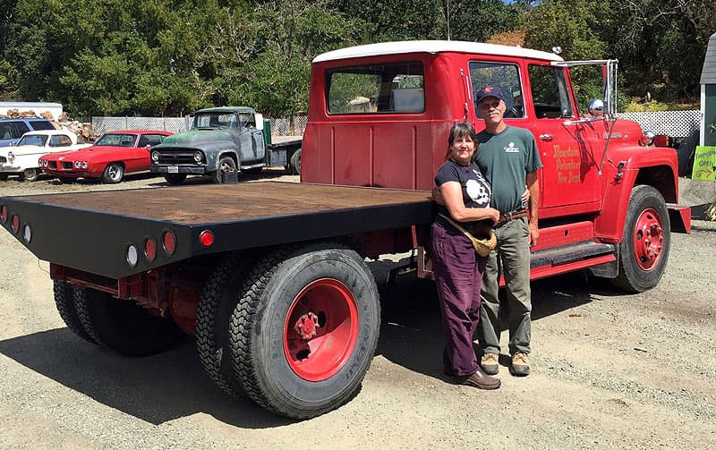 Thomas and Sequoia with their flatbed fire truck