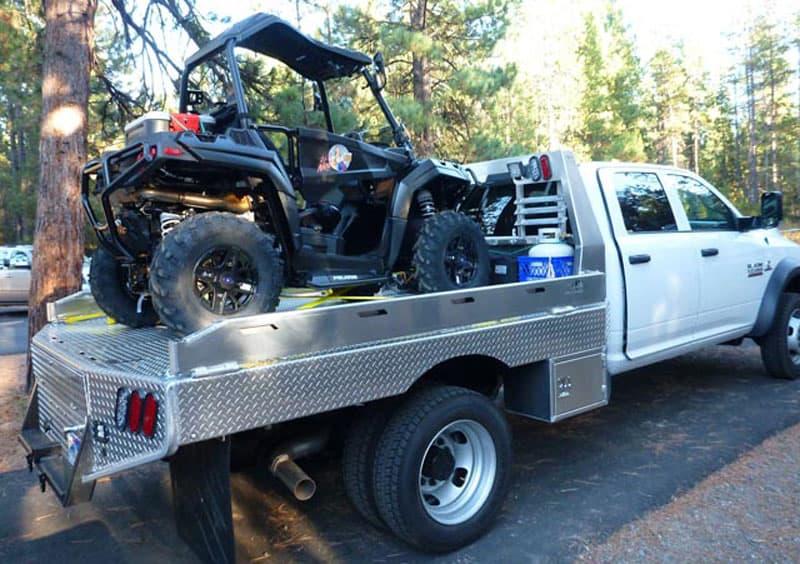 Flatbed Truck Hauling ATV