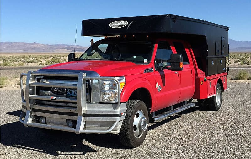 Ford F350 flatbed with Phoenix Camper