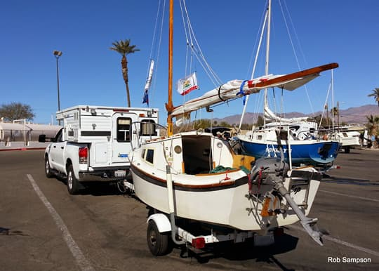 tugboat-four-wheel-camper-towing-sailboat