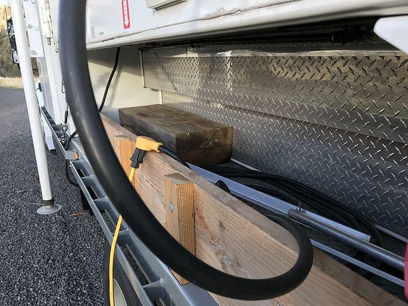 Side bin storage under camper