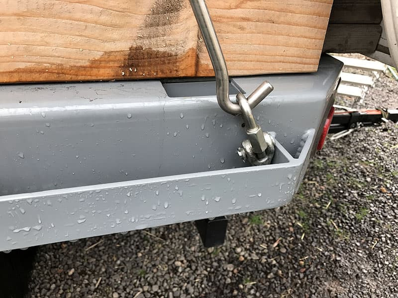 Freightliner truck camper tie-downs and turnbuckles on rub rail