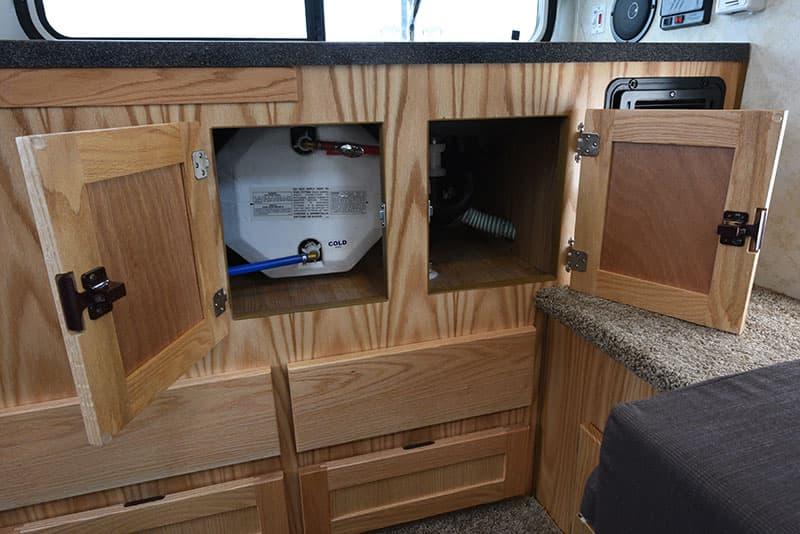 Hallmark Milner Kitchen cabinetry with water heater