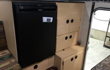 Refrigerator and storage in Four Wheel Camper Grandby