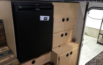Refrigerator and storage in Four Wheel Camper Grandby