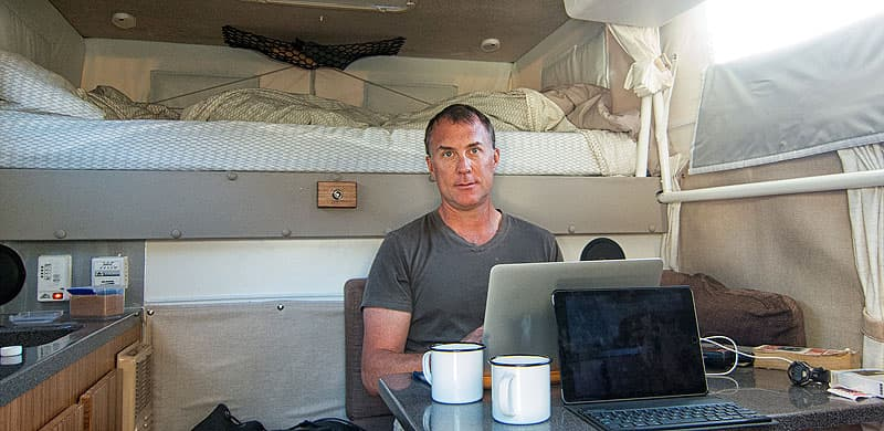 John inside Hallmark Pop-Up Camper