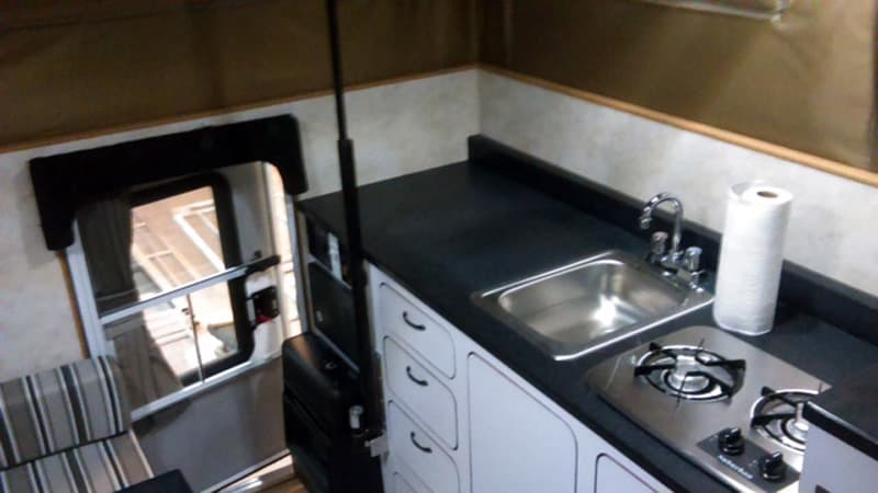 Black Staron solid surface countertops and white cabinetry