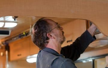 John Sawvel, working on camper interior cabinets