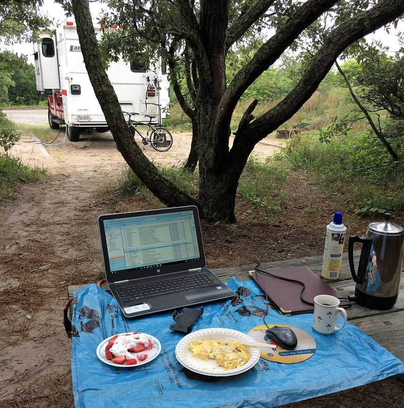 Laptop reading at a campground