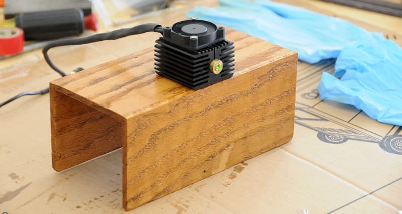 Laser-operating-attached-to-wooden-support-to-hang-on-truck-rear-seat