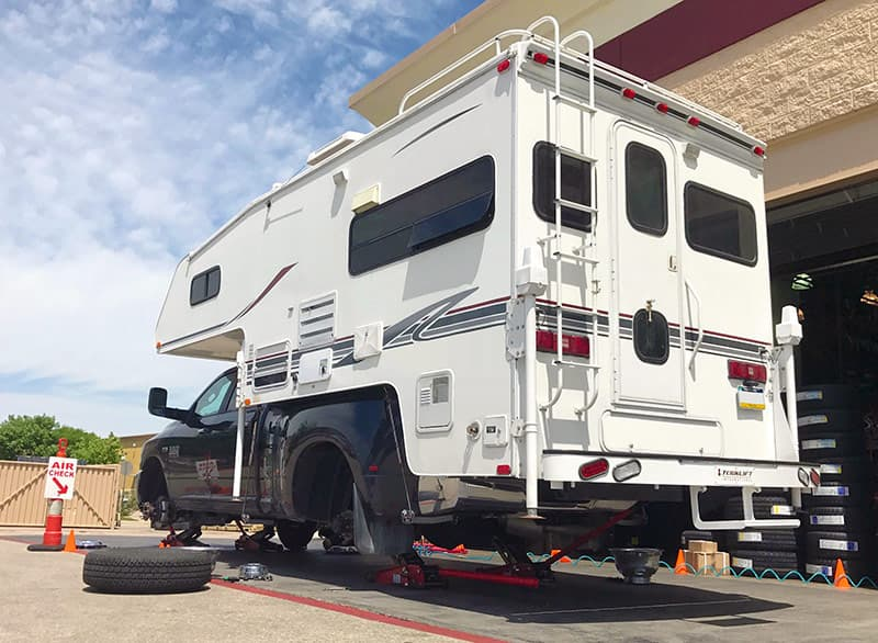 Truck camper levitating above the ground