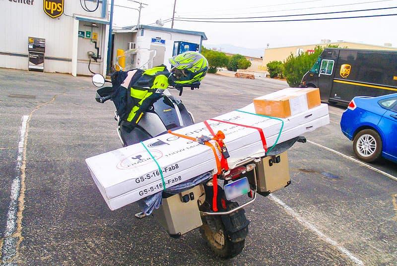 Mail-on-motorcycle-solar-panel-delivery