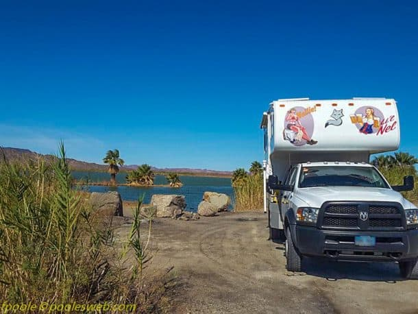 #247 - Frank PooleMittry Lake, Yuma, Arizona2016 Ram 5500 HD2006 Arctic Fox 990Camera Used - Phone Samsung 7eThis is a little known lake.  There were dirt roads which demanded it to be checked out. I felt like I was in the tropics with water and palm trees.  I kept looking for the Hula Girls, but I'll keep looking for the rest of my life because it's not happening today.  Nice place.  The sites are a little sparse on the lake, but I lucked out. Fun.