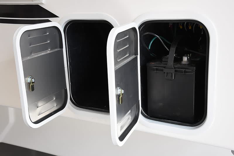 Two battery storage compartments in a Northern Lite 10-2 EX truck camper