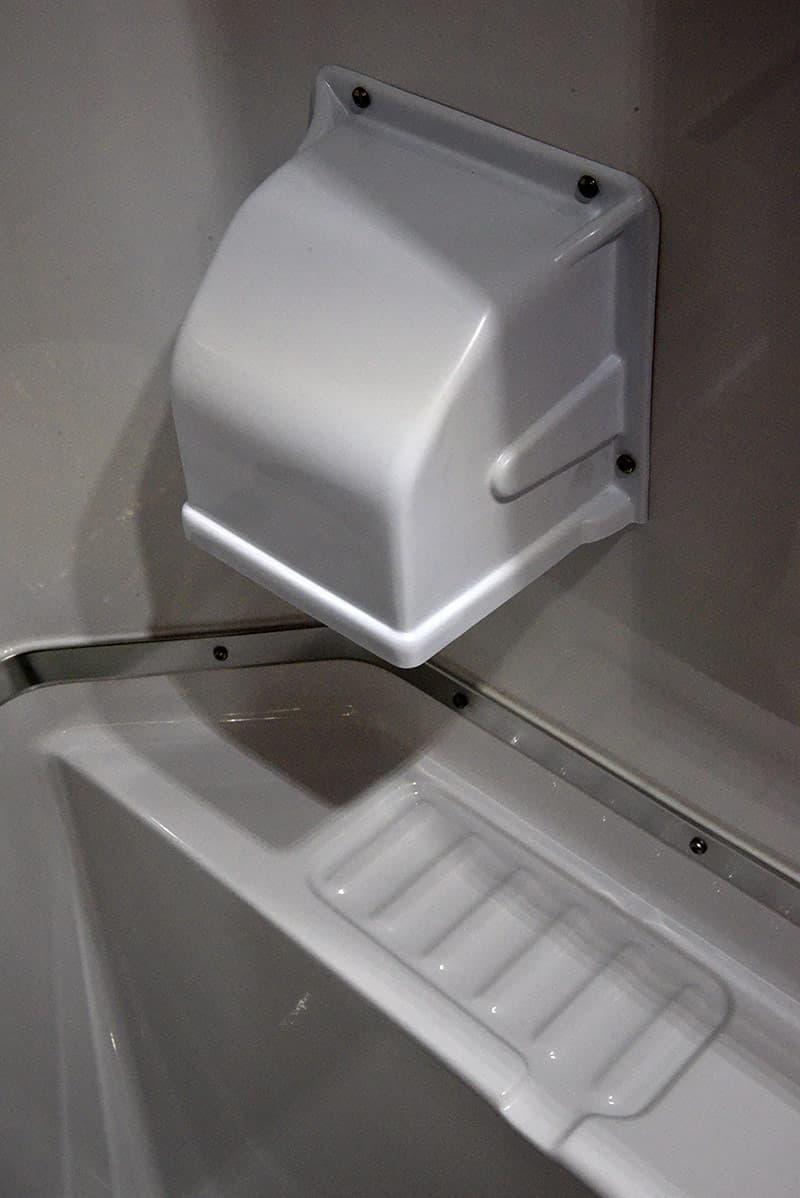 Toilet paper holder in wet bath camper
