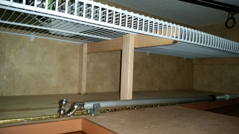 Supports in dinette bunk for storage