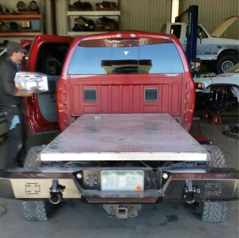 1.5-inch deep custom diamond plate flatbed truck