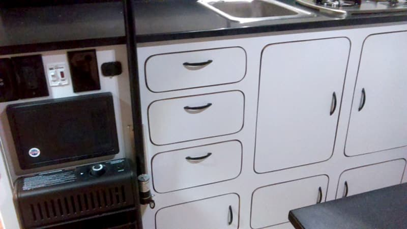 Modern white cabinetry in a pop-up camper