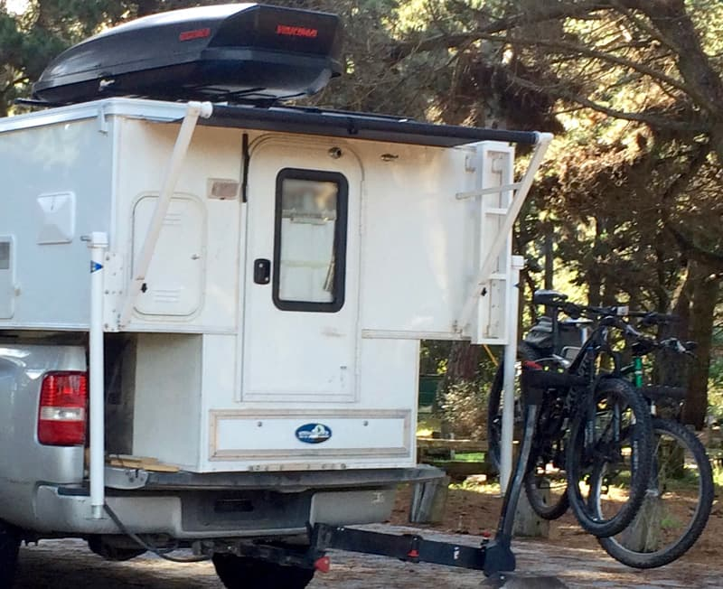 Swing out bike rack and exterior drawer storage