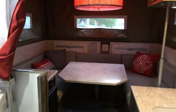Phoenix-flatbed-Ford-Camper-dinette and lamp
