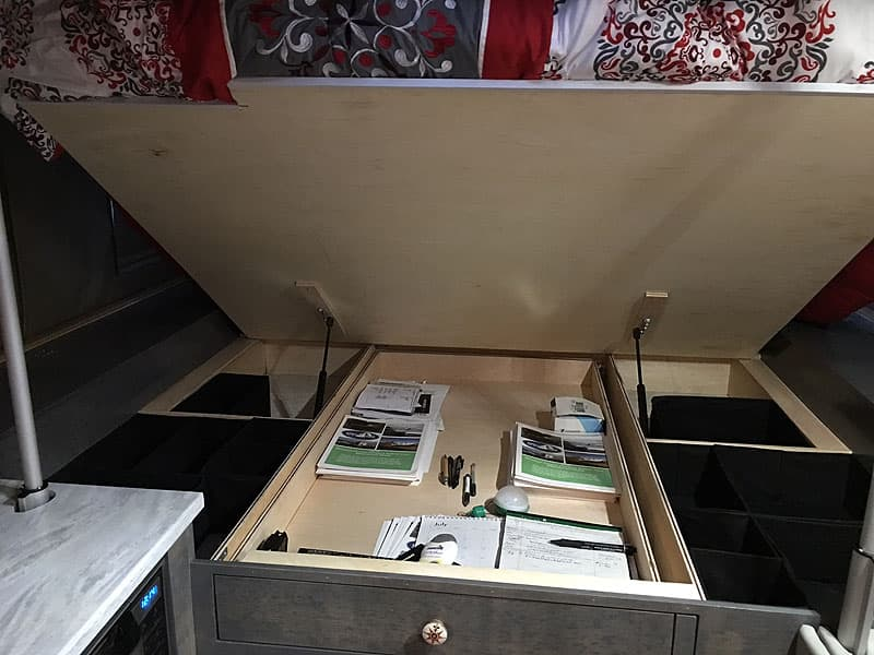 Under bed storage in the Phoenix flatbed camper
