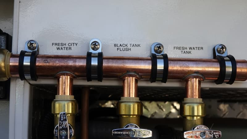 fresh tank, city water and black tank flush in one area