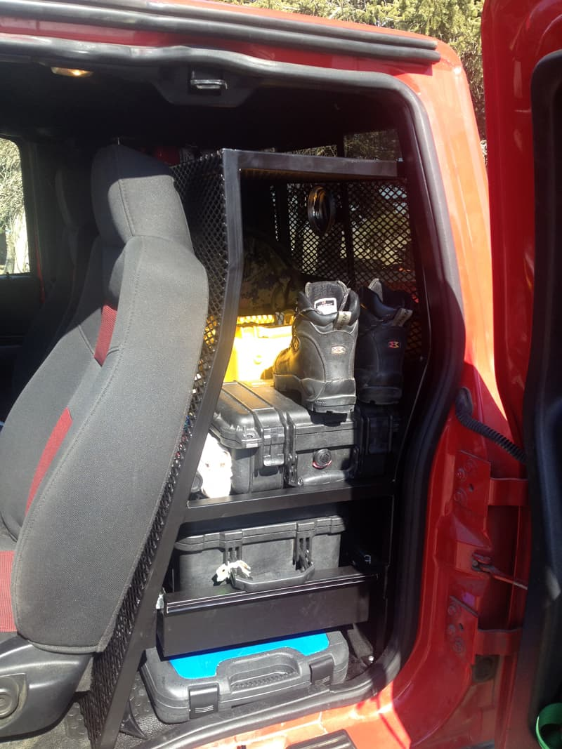 Storage compartment organizes back of truck