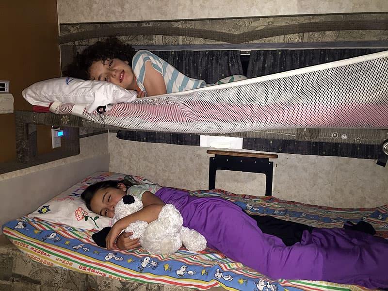 Sleeping in bunk beds in truck camper dinette