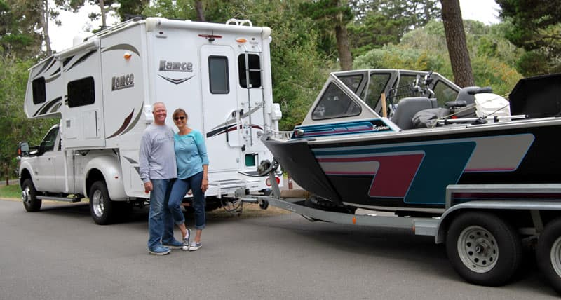 Rosemary and Mark Hellwig with boat and camper