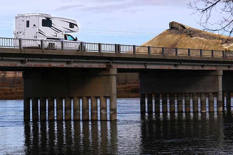 Rugged Mountain RV Camper on bridge