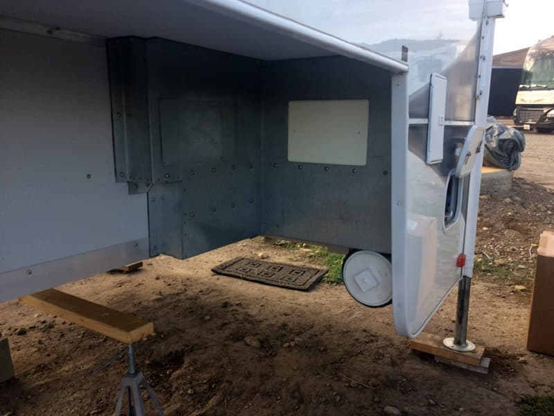 sewer hose modification in back wall of camper