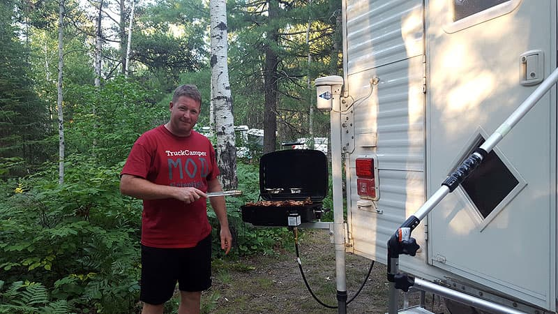 Brian Sibbles using the barbecue