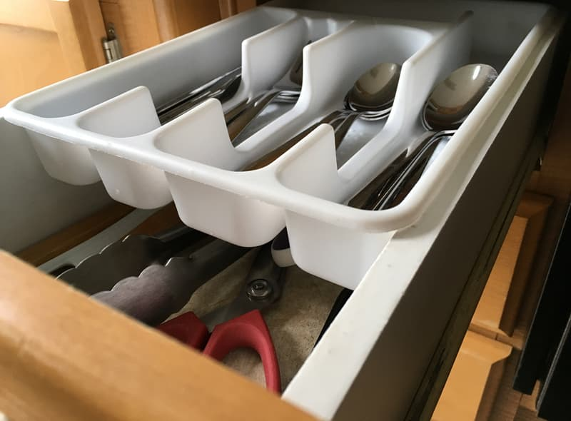 Silverware container on top drawer rails