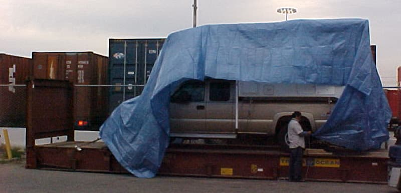 Tarping on flat rack carrier for roll-on roll-off
