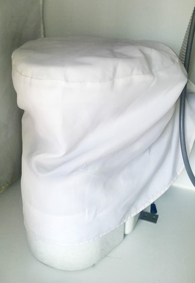 Toilet cover for a truck camper